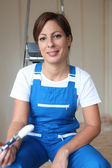 Smiling woman painting — Stock Photo