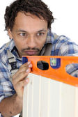 Carpenter using a spirit level — Stock Photo