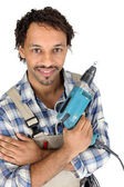 Tradesman holding an electric screwdriver — Stock Photo
