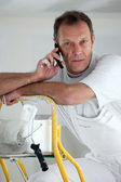 Portrait of a painter on the phone — Stock Photo