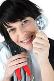 Electrician holding replacement light bulb — Stock Photo
