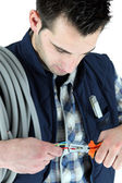 Electrician clipping electric cable — Stock Photo