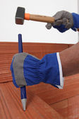 Bricklayer with a hammer and chisel — Stock Photo
