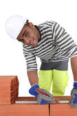 Bricklayer with a pencil and ruler — Stock Photo