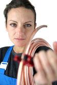 Female plumber cutting copper pipe — Stock Photo