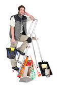 Tiler surrounded by his equipment — Stock Photo