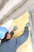 Man insulating wall — Stock Photo