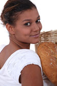 Young female baker — Stock Photo