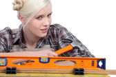 Blonde holding a hammer — Stock Photo