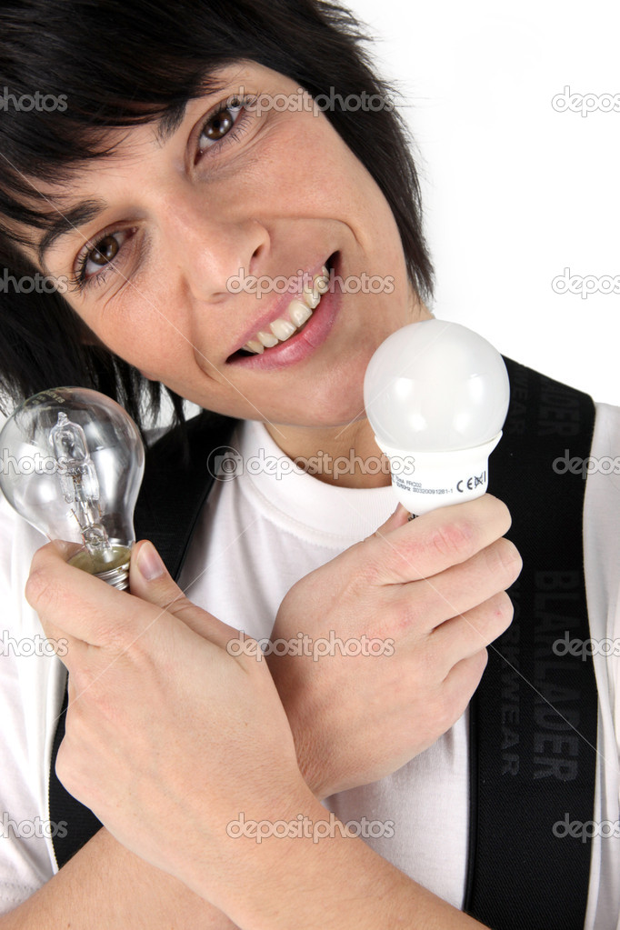 Portrait of woman holding two light bulbs — Stock Photo #10281248