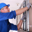Electrician installing wiring — Stock Photo #10321013
