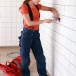 Female electrician working in bathroom — Stock Photo
