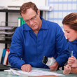 Worker and intern checking stock levels — Stock Photo