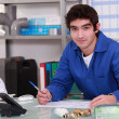 Young worker in warehouse — Stock Photo