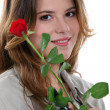 Woman with a red rose and a pair of secateurs — Stock Photo