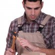 Carpenter with a hammer and a chisel — Stock Photo #10324621