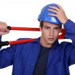 Manual worker posing with bolt cutters — Stock Photo