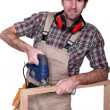 Carpenter using drill — Stockfoto