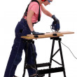 Woman carpenter using a jigsaw. - Foto Stock