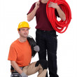 A team of construction workers with their tools and building materials — Stock Photo