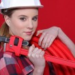 Female plumber equipped to fix problem — Stock Photo #10326979