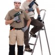 Stock Photo: Two craftsmen holding drills