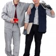Two handymen working together - Stock Photo