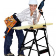 Craftswoman holding a drill — Stock Photo
