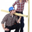 Male and female carpenters - Stockfoto