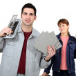 Couple with a tile cutter — Stock Photo