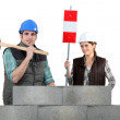 Mand and woman with hammer — Stock Photo