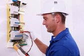 Electrician measuring voltage — Stock Photo