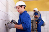 Two electricians — Stock Photo