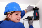 Woman with electric drill — Stock Photo