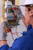 Female electrician with voltmeter — Stock Photo