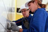 Electricista y su aprendiz — Foto de Stock