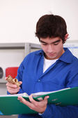 Young person with piece of plumbing — Stock Photo