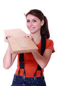 Handywoman holding wooden boards — Stock Photo