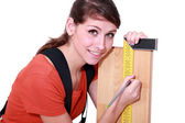Woman marking plank of wood using set-square — Stock Photo