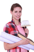 Woman with wallpaper — Stock Photo