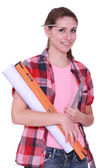 Female labourer holding spirit level — Stock Photo