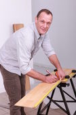 Carpenter marking wood — Stock Photo