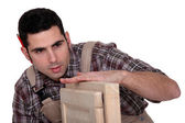 Carpenter with cabinet doors — Stock Photo