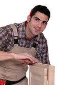 Woodworker finishing a window frame — Stock Photo