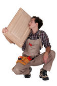 Carpenter holding a wooden window — Stock Photo