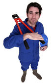 Builder with a pair of bolt cutters — Stock Photo