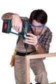 Man using an electric screwdriver — Stock Photo
