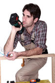 Woodworker thinking — Stock Photo