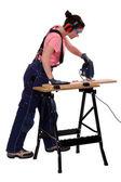 Woman carpenter using a jigsaw. — Stock Photo
