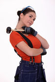 Working woman with mace on his shoulder — Stock Photo